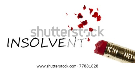 Insolvent word erased by pencil eraser - stock photo