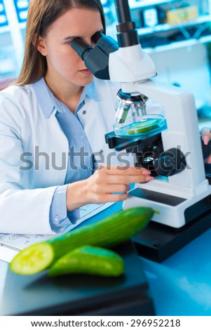 Inspection of fruits and vegetables for harmful substances - stock photo