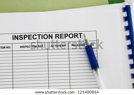 inspection report form with folder and pen concept. - stock photo