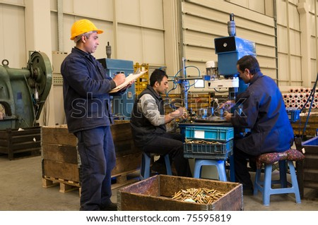 Inspector checking workers at factory motion blurred - a series of INDUSTRIAL images. - stock photo