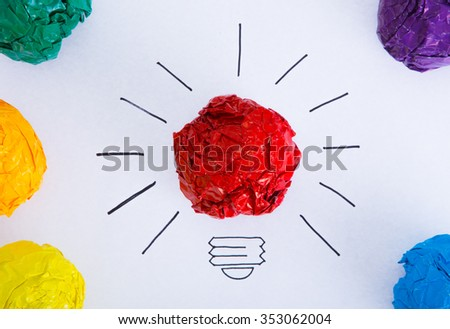 Inspiration concept crumpled color paper light bulb metaphor for good idea.