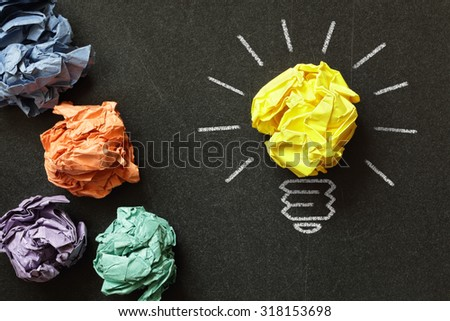Inspiration concept crumpled paper light bulb metaphor for choosing the best idea - stock photo