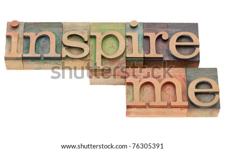 inspiration concept - inspire me isolated phrase in vintage wood letterpress printing blocks