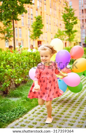 inspiration, happy little girl outdoors with balloons