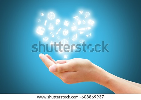 inspiration of Learning and Education concept, Hand with knowledge icon decorate to heart symbol with blue background