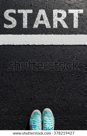 "Inspiration quote : "" Start now"" on aerial view of running shoe  on road with move forward yellow arrow ,Motivational typographic."