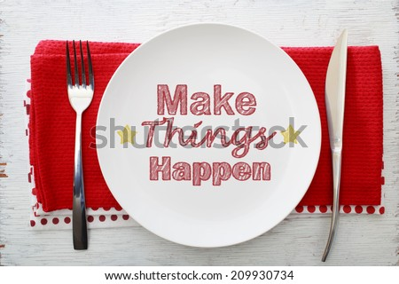 Inspirational Meal Make Things Happen with Table Settings - stock photo