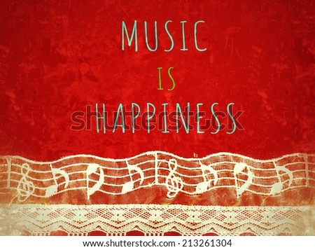 Inspirational motivating quote with music note made from cloth and retro filter effect  :Music is Happiness  - stock photo