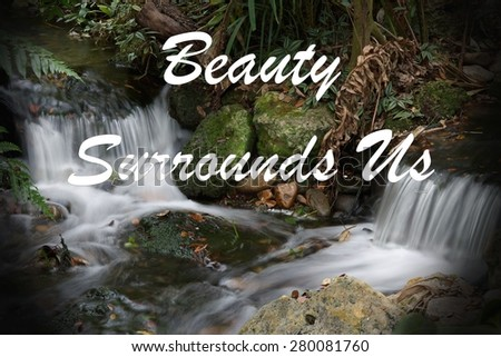 Inspirational quote about life, love, and spirituality with a beautiful waterfall in the background.  - stock photo