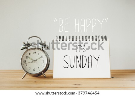 Inspirational quote : Be happy it's sunday - stock photo