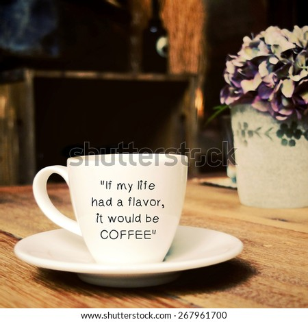 Inspirational quote on cup of coffee with retro filter effect - stock photo