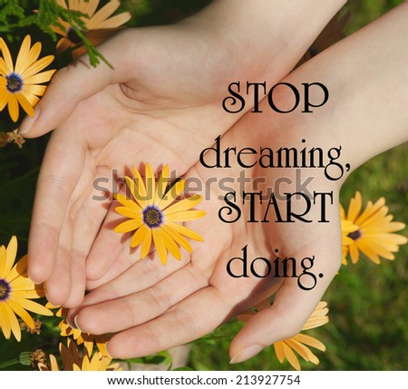 Inspirational quote on life by an unknown author with a young woman's hand cupping an African daisy flower in the summertime. - stock photo
