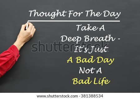 Inspirational Thought For The Day message of  Take A Deep Breath - It's Just A Bad Day Not A Bad Life written on a School Blackboard by the teacher. - stock photo