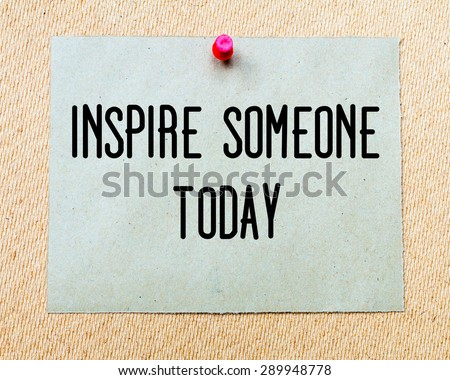 Inspire Someone Today  written on paper note pinned with red thumbtack on wooden board. Motivation conceptual Image - stock photo