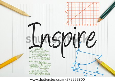 Inspire written in the notebook - stock photo