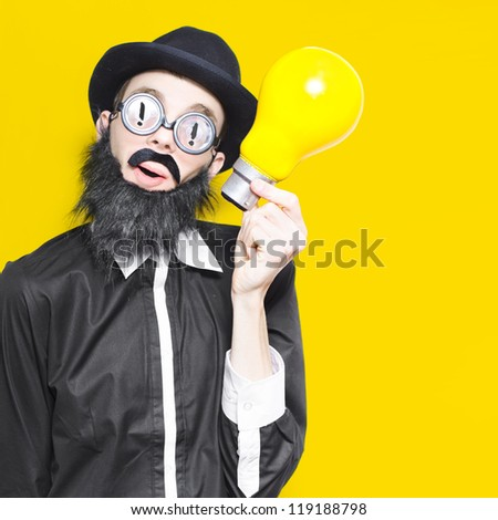 Inspired Marketing Businessman Wearing Humorous Glasses And Fake Beard Holding Massive Light Bulb In A Depiction Of A Big Idea - stock photo
