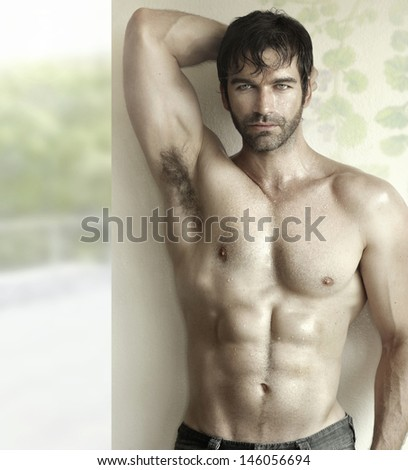 Inspiring sensual portrait of a sexy male fitness model - stock photo