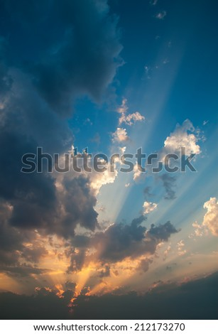 Inspiring sunset with dramatic sky, clouds and sunbeams. - stock photo