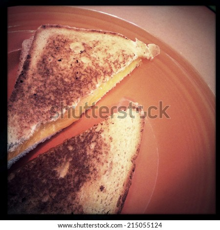 Instagram filtered image of a grilled cheese sandwich - stock photo