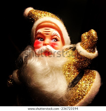 Instagram filtered image of a vintage 1950 gold sparkly Santa Claus  - stock photo