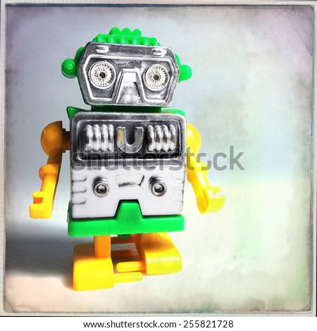 Instagram filtered image of a vintage toy plastic robot - stock photo