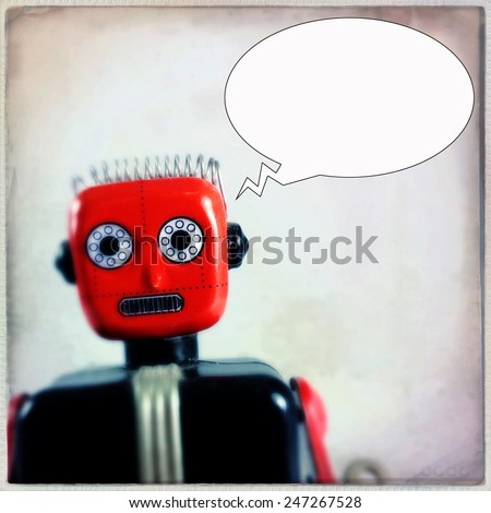 Instagram filtered image of a vintage toy robot with a thought bubble  - stock photo