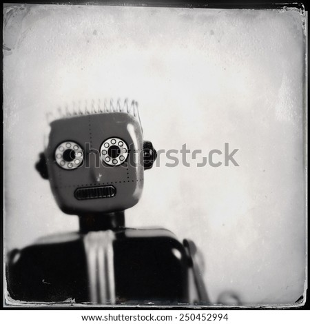 Instagram filtered image of an old toy robot - stock photo