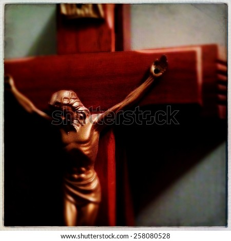 Instagram filtered image of Jesus on the cross - soft focus - stock photo