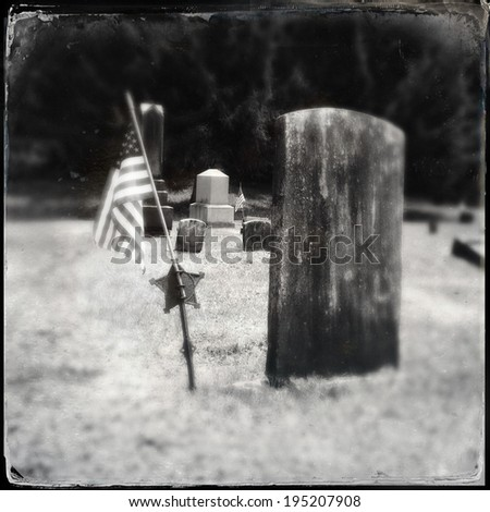Instagram filtered style image of a Civil War era grave and American Flag - stock photo