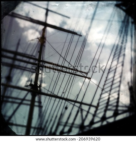 Instagram filtered style image of sailing ship masts - stock photo