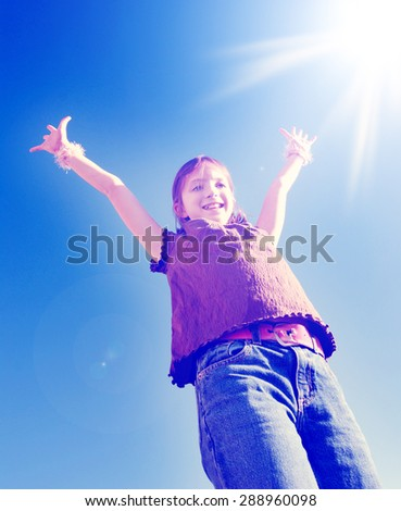 Instagram of young joyful girl with arms raised up towards perfect blue sky and sunshine - stock photo