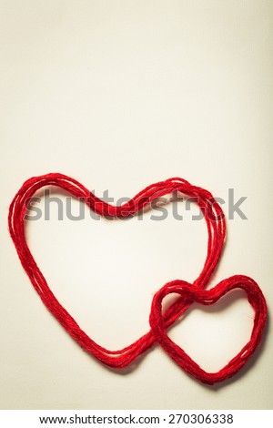 Instagram. Sentence I love you and a heart-shaped roll of wire on a beige background, with a retro effect - stock photo