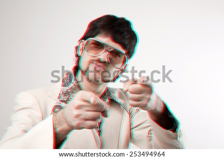 Instagram style portrait of a retro man in a 1970s leisure suit and sunglasses pointing to the camera with a 3D effect - stock photo