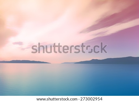 instagram style subtle blurry summer background landscape with trendy colorful filter overlay. Blue ocean with hills and mountains in the distance on a warm pink sunset - stock photo