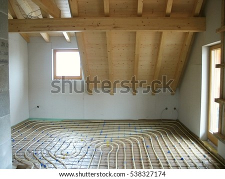 Installation of PE-Pipes for underfloor Heating on Foil