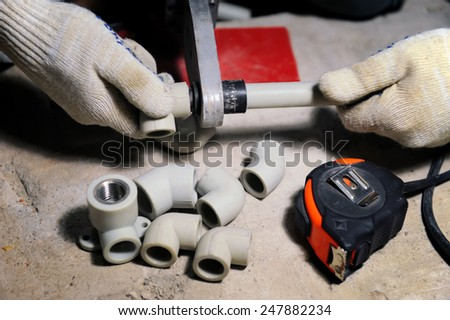 Installation of plastic pipes welder machine and hydraulic tools - stock photo
