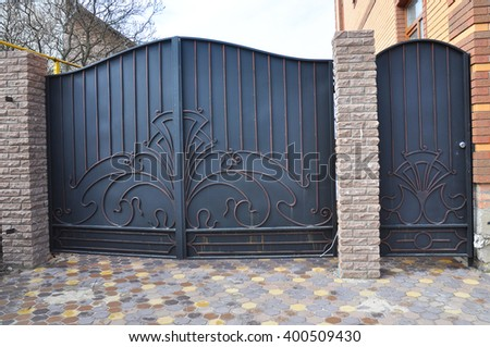 Installation Of Stone And Metal Fence With Door And Gate For Car.