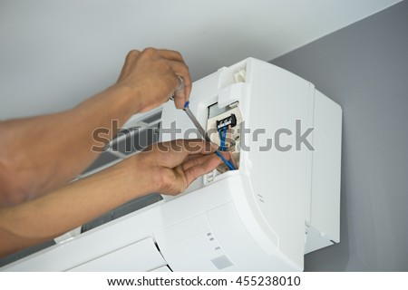installation of the air conditioner, worker connects electric wires