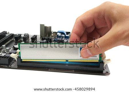 installing a memory module on the motherboard - stock photo