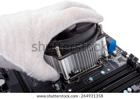 Installing CPU cooler on modern PC computer motherboard - stock photo