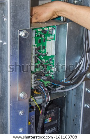 Installing elevator control panel, elevator parts installation - stock photo