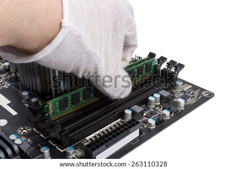Installing memory module in DIMM slot on modern PC computer motherboard - stock photo