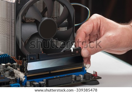 Installing memory module slot on  computer motherboard - stock photo