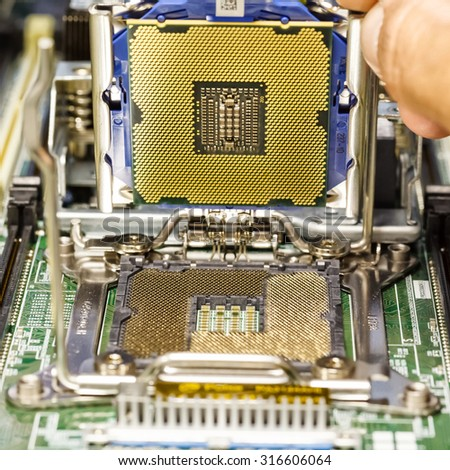 installing the CPU on server motherboard closeup - stock photo