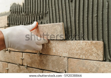 Installing Tiles On Wall Worker Putting Stock Photo (Royalty Free ...