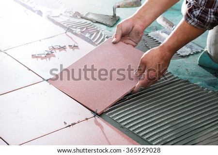 Installing Tiles - Professional Mason  - stock photo