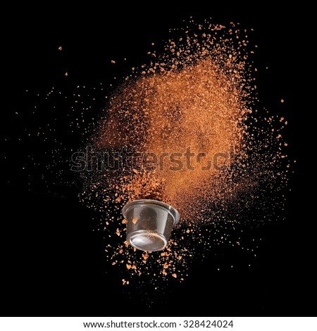 Instant coffee explosion from a capsule - stock photo