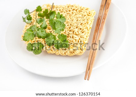 instant noodle in white dish with chopstick - stock photo