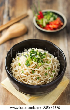Instant noodles in white black on wood background - stock photo