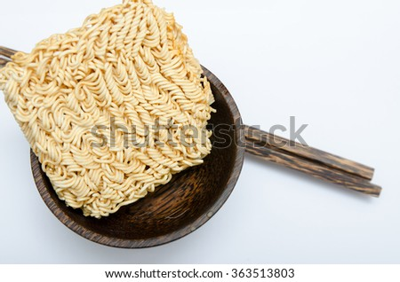 Instant noodles in wood cup, isolated on white background